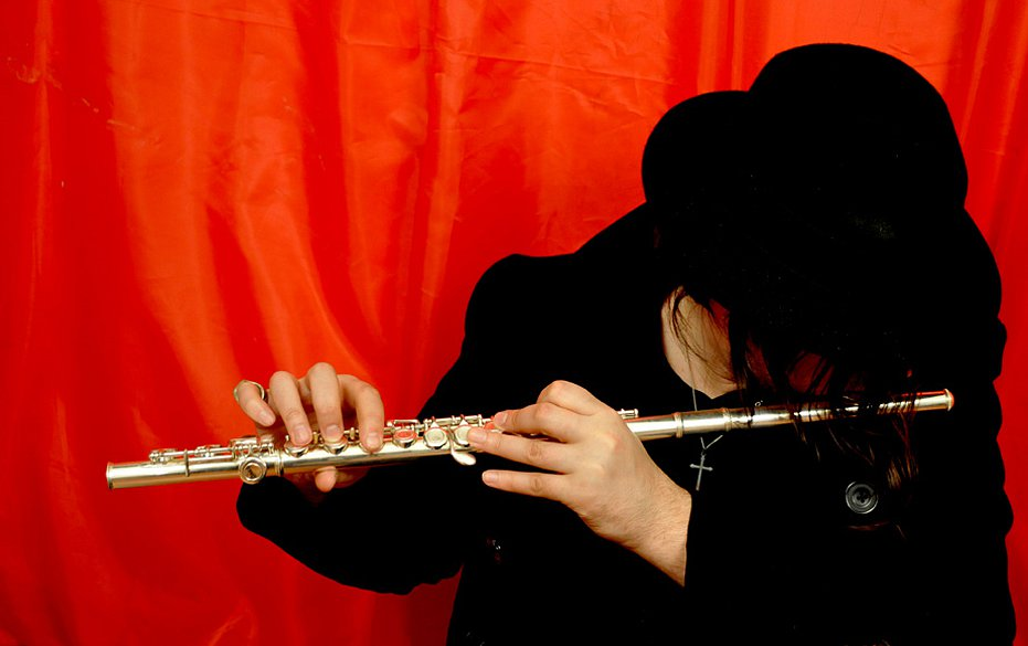 Playing flute in red, 2011